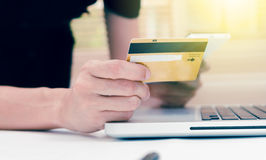 The online shopping card and holding credit card with hand for p Stock Image