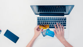 The online shopping card and holding credit card with hand for p Royalty Free Stock Photos