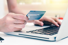 The online shopping card and holding credit card with hand for p Royalty Free Stock Image