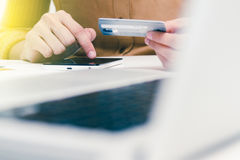 The online shopping card and holding credit card with hand for p Stock Photography