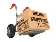 Online Shopping - Cardboard Box on Hand Truck. Stock Images