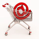 Online shopping cart. A shopping cart with at the rate symbol showing online shopping concept on the rise Royalty Free Stock Image