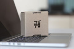 Online shopping cart. Concept with laptop and cardboard box Stock Photo