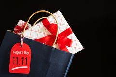 Online shopping of China, 11.11 single day sale concept. Shopping bag and gifts boxes with message tag royalty free stock image