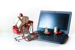 Online shopping for christmas, baubles and gift boxes in a cart Royalty Free Stock Images