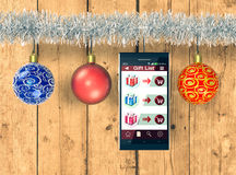 Online shopping and Christmas gifts. Smartphone with an app for online shopping and Christmas decorations, wooden background (3d render Stock Image