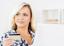 Online shopping concept. Beautiful blond girl with a credit card Royalty Free Stock Photography
