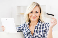 Online shopping concept. Beautiful blond girl with a credit card.  Stock Images