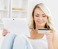 Online shopping concept. Beautiful blond girl with a credit card Stock Photos