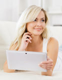 Online shopping concept. Beautiful blond girl with a tablet computer Royalty Free Stock Images