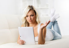 Online shopping concept. Beautiful blond girl with a tablet computer Stock Images