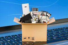 Online Shopping concept, cardboard box full of home appliances o Royalty Free Stock Photo
