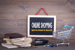 Online shopping concept. Chalkboard on a wooden background.  Stock Photography