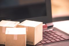 Online shopping concept e-commerce delivery buying service. square cartons shopping on laptop keyboard, showing customer order vi. A the internet stock photo