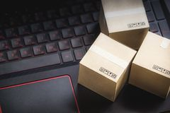 Online shopping concept e-commerce delivery buying service. squa. Re cartons shopping on laptop keyboard, showing customer order via the internet stock photography