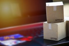 Online shopping concept e-commerce delivery buying service. squa. Re cartons shopping on laptop keyboard, showing customer order via the internet and credit card royalty free stock image