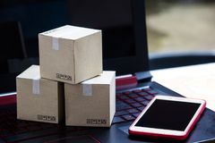 Online shopping concept e-commerce delivery buying service. square cartons shopping on laptop keyboard, showing customer order vi. A the internet and smartphone royalty free stock photo
