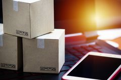 Online shopping concept e-commerce delivery buying service. squa. Re cartons shopping on laptop keyboard, showing customer order via the internet and smartphone stock image
