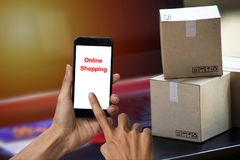 Online shopping concept e-commerce delivery buying service. square cartons shopping on laptop keyboard, showing customer order vi