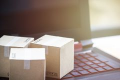 Online shopping concept e-commerce delivery buying service. squa. Re cartons shopping on laptop keyboard, showing customer order via the internet stock image