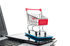 Online shopping concept - Empty Shopping Cart, laptop and tablet pc, smartphone isolated on white background. Copy space Royalty Free Stock Images