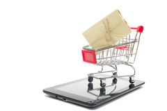 Online shopping concept - Empty Shopping Cart, laptop and tablet pc, smartphone isolated on white background. Copy space Royalty Free Stock Photography