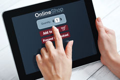 Online shopping concept. Female hands using touch screen device for online shopping Royalty Free Stock Photos