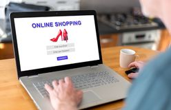 Online shopping concept on a laptop. Man using a laptop with online shopping concept on the screen royalty free stock photo