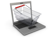 Online shopping concept with laptop and shopping basket Royalty Free Stock Images