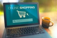 Online shopping concept laptop on table Royalty Free Stock Photos
