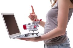The online shopping concept with laptop and trolley. Online shopping concept with laptop and trolley Royalty Free Stock Photo