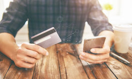 Online shopping concept. Man is holding credit card and using smartphone. Online shopping concept. Close up stock images