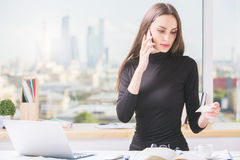 Online shopping concept. Portrait of gorgeous young woman making order by phone. Online shopping concept stock image