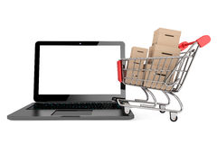 Online shopping concept. Shopping Cart with Boxes over Laptop Royalty Free Stock Images