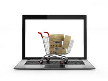 Online shopping concept. Shopping Cart with Boxes over Laptop Royalty Free Stock Photo