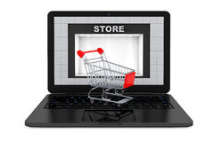 Online Shopping Concept. Shoppping Cart over Laptop with Store B Royalty Free Stock Image