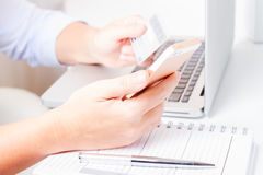 Online shopping concept. Someones hands holding mobile phone and credit card, making on-line payment Royalty Free Stock Images