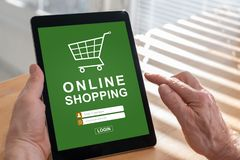 Online shopping concept on a tablet. Tablet screen displaying an online shopping concept royalty free illustration
