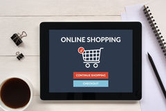 Online shopping concept on tablet screen with office objects Stock Photography