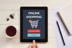 Online shopping concept on tablet screen with office objects Stock Image