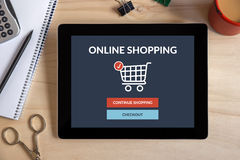 Online shopping concept on tablet screen with office objects Royalty Free Stock Photography