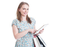 Online shopping concept with woman and gift bags Stock Photo