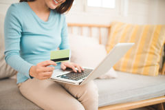 Online shopping concept. Young asian woman holding credit card a Stock Image