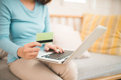 Online shopping concept. Young asian woman holding credit card a Royalty Free Stock Images