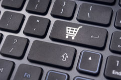 Online shopping concepts with cart symbol Stock Photos