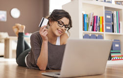 Online shopping by credit card. Happy woman doing online shopping at home Stock Photo