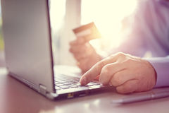Online shopping with credit card and laptop computer royalty free stock photos
