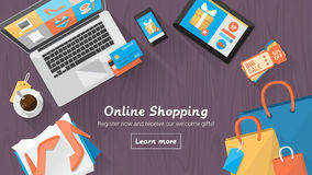 Online shopping desktop. Online shopping concept desktop with computer, table, shopping bags, credit cards, coupons and products royalty free illustration