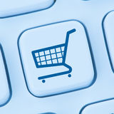 Online shopping e-commerce ecommerce internet shop concept blue. Computer web keyboard royalty free stock photo