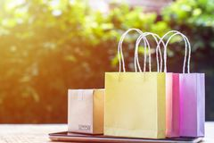 Online shopping, E-commerce, fast and easy trading concept : Col. Orful shopping bags, Paper carton on tablet depicts customers order things from retailer sites stock photography